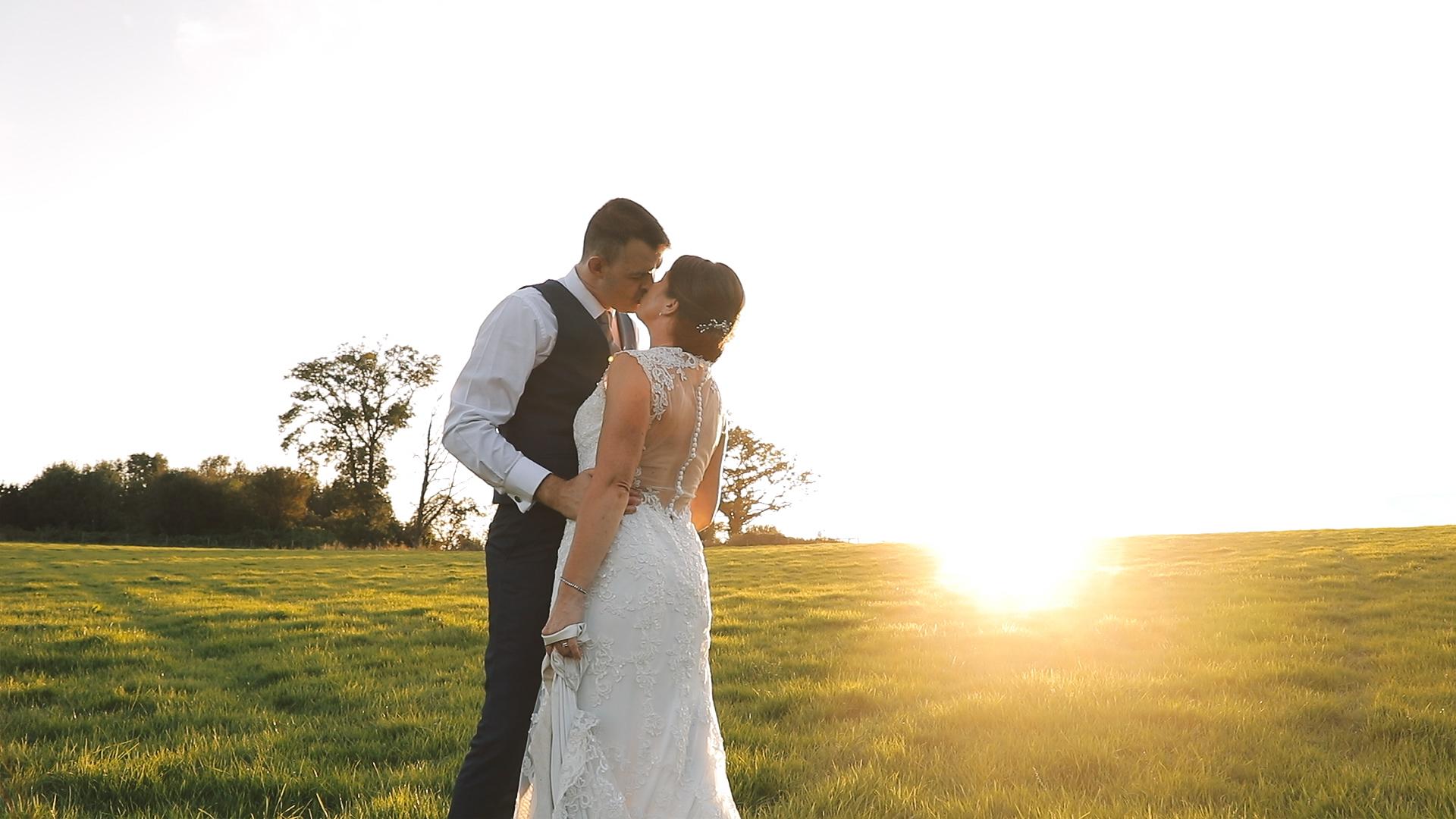 E&W sunset kiss wide shot