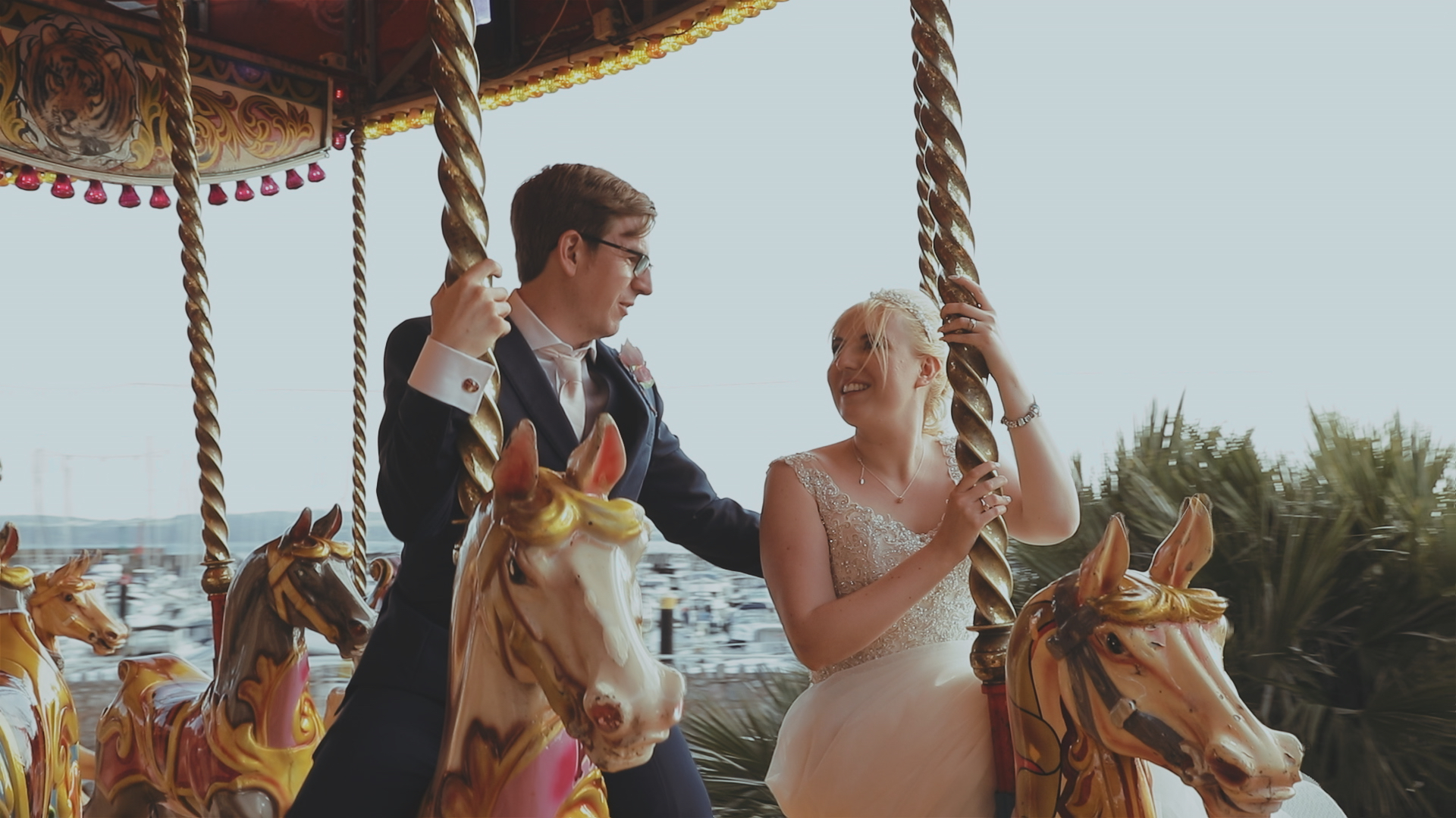Bride and Groom on a carousel, Torquay