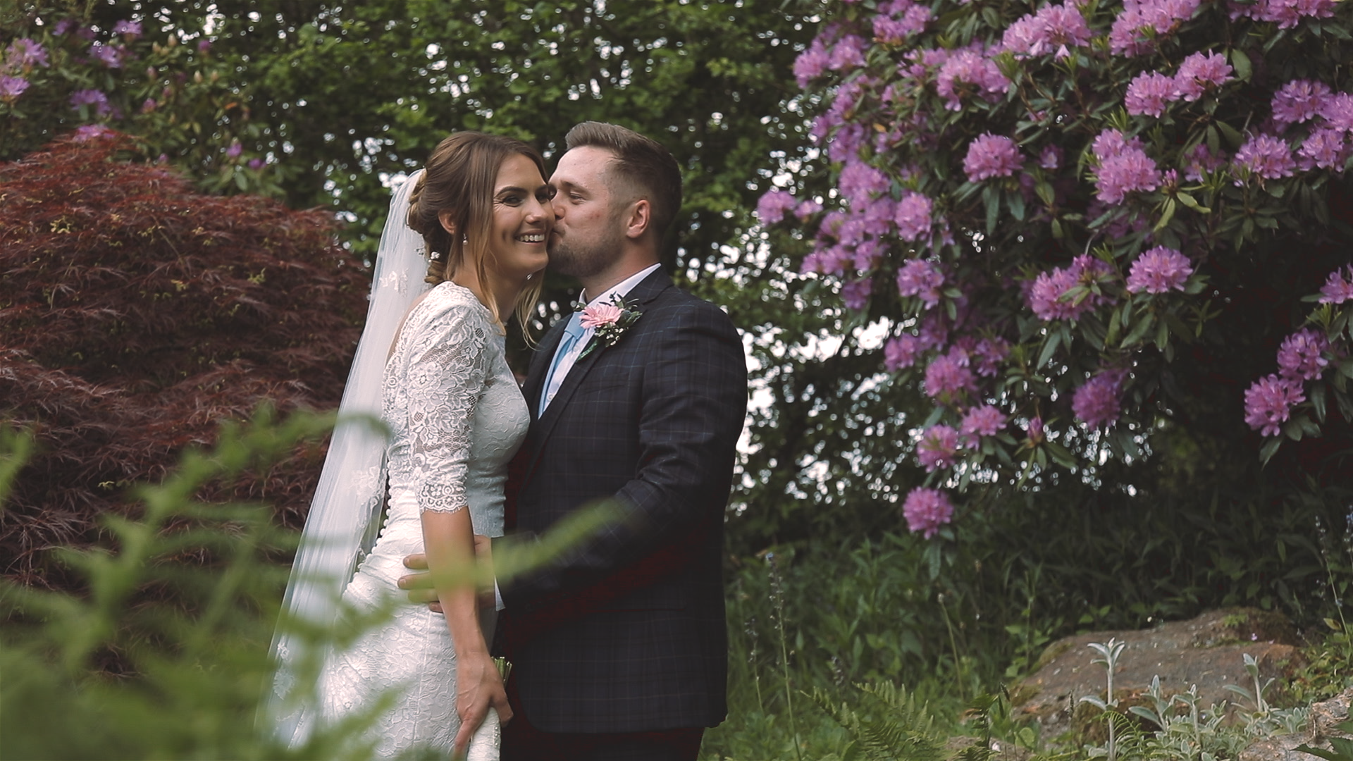 Bride and Groom surrounded by flowers